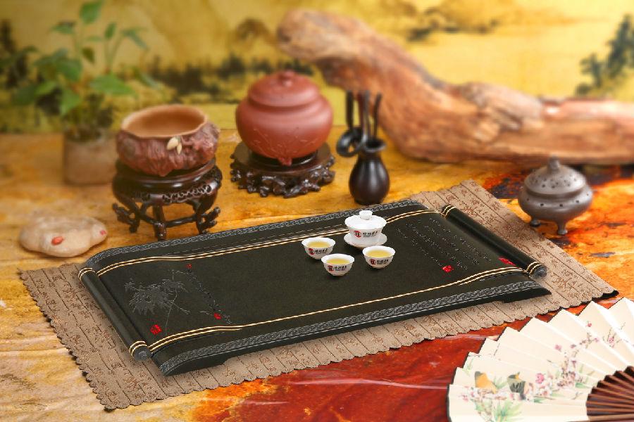 公司专业生产各种石茶盘,专注于乌金石,皇廷玉石,紫金木鱼石,天山绿